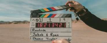a person holding a clapperboard